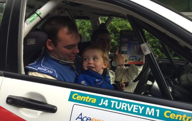 "<span class=""light"">Aaron</span> with his son and Paul McGee Group N Champions"