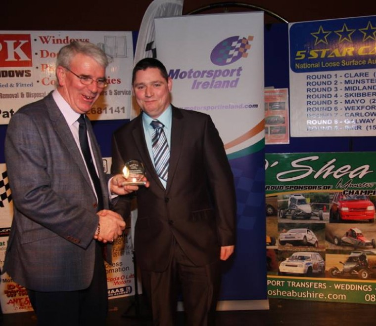 "<span class=""light"">Stephen</span> McGing recieves COC award from Martin McKenna"